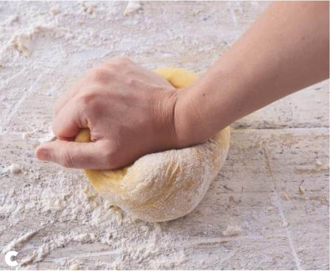 Knead the dough as if making bread: push down on the dough with the heel of your hand