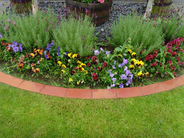 Creativity in bordering your garden beds with terracotta