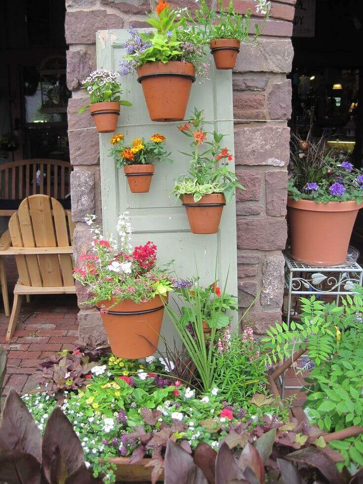 Terra Cotta Pots Hung From a Door