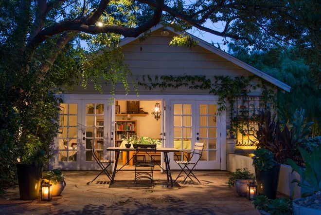Nothing ruins nighttime patio enjoyment like turning on the lone, way-too-bright spotlight you have in your backyard. Softer lighting on the ground and off the house can create a more pleasant mood. If you're ready to invest in lighting, collect a few hurricanes and lanterns to keep the flames from blowing out in the breeze.