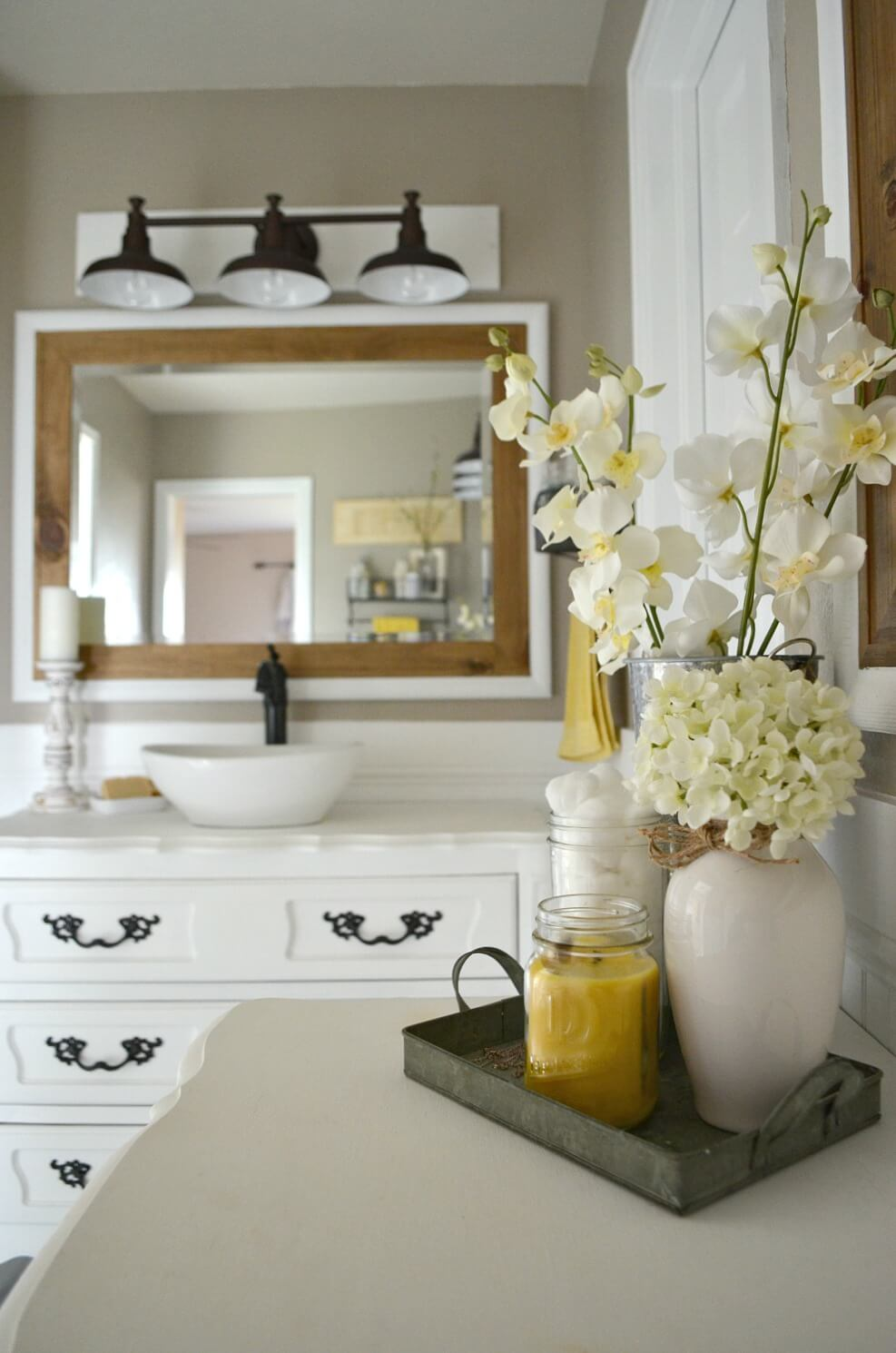 Bright Farmhouse Bathroom with Wood and Flowers