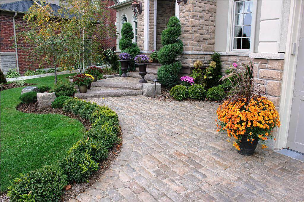 Structured Evergreen Garden Beds with Colorful Planters