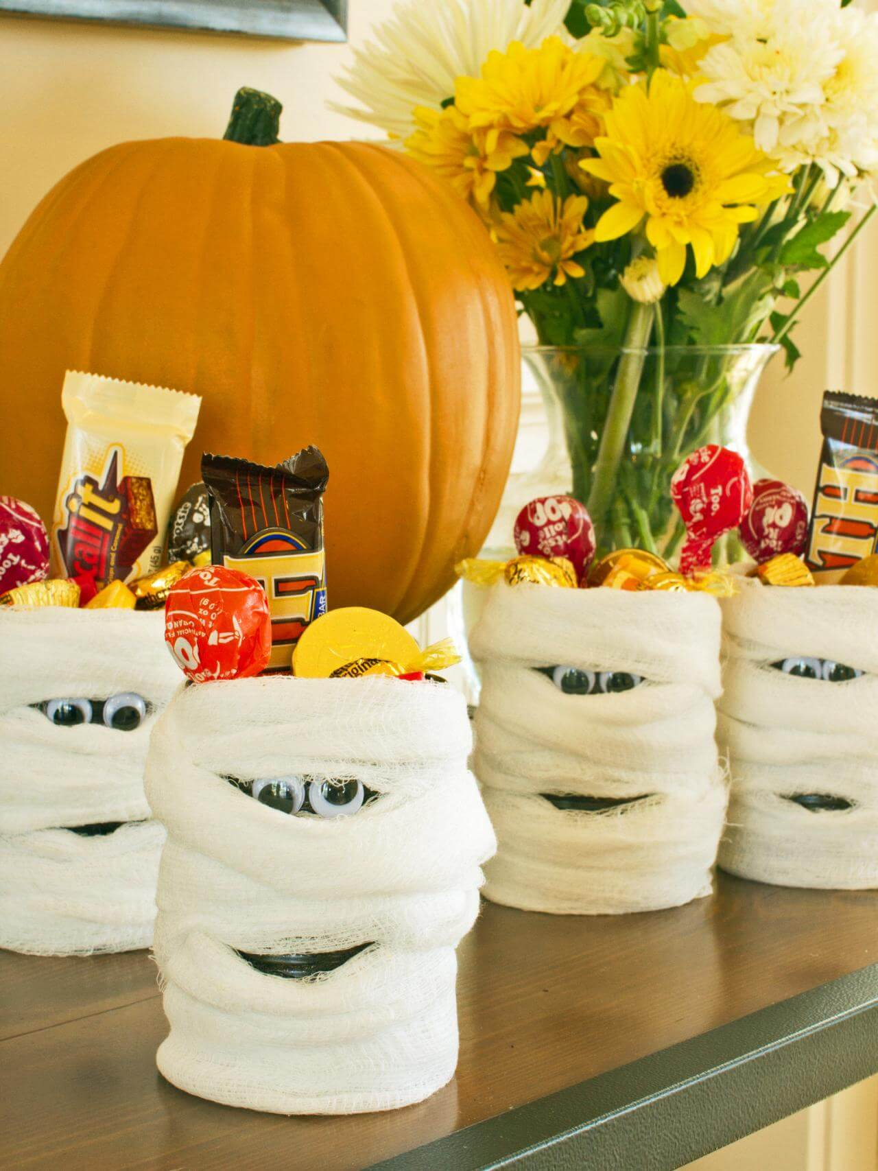 Mummy Candy Cans for Take-Home Treats | Awesome DIY Halloween Party Decor | BHG Halloween