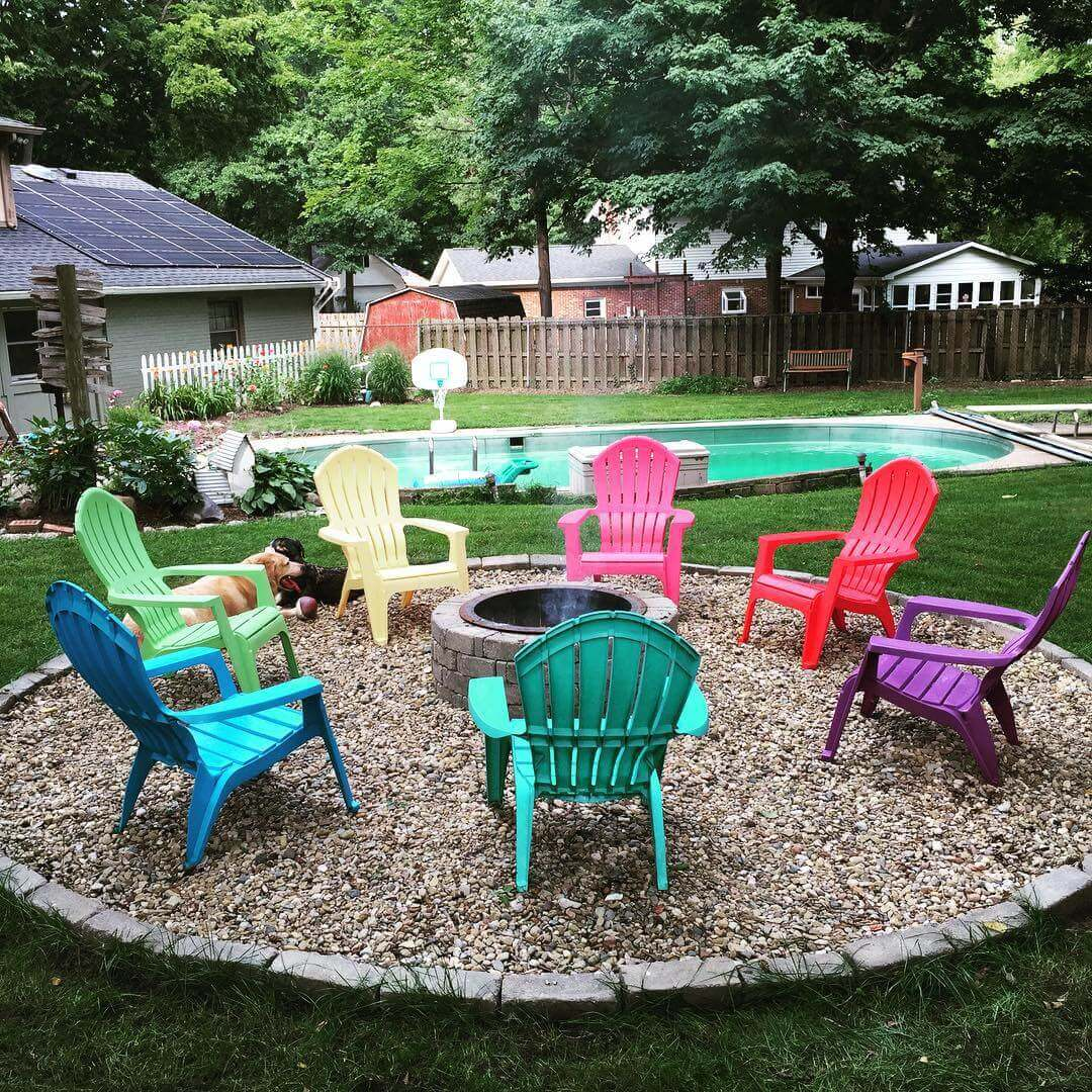 Stone Pit with a Rainbow of Chairs   Awesome Firepit Area Ideas For Your Outdoor Activities