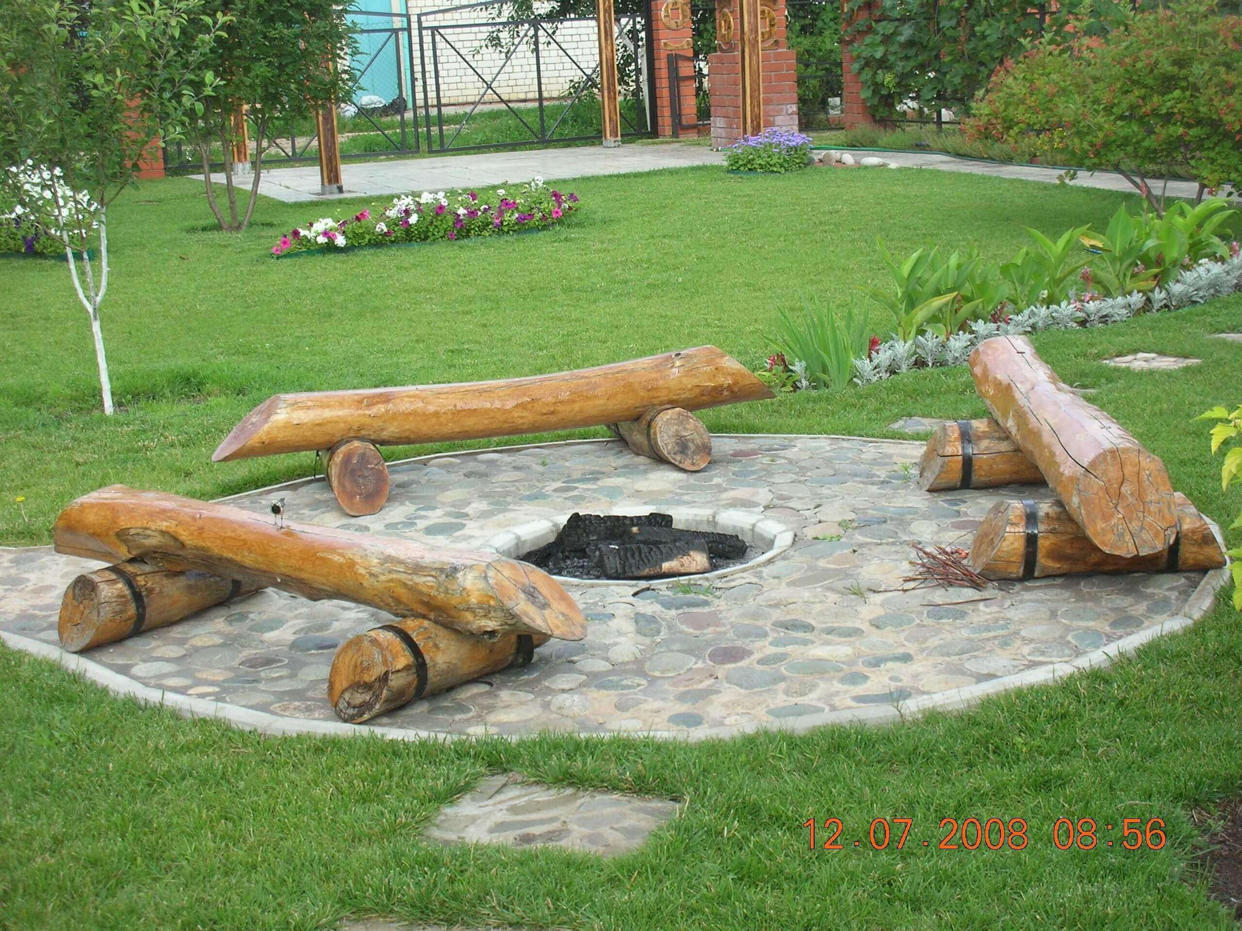 Log Benches Surrounding a Pit in Stone   Awesome Firepit Area Ideas For Your Outdoor Activities
