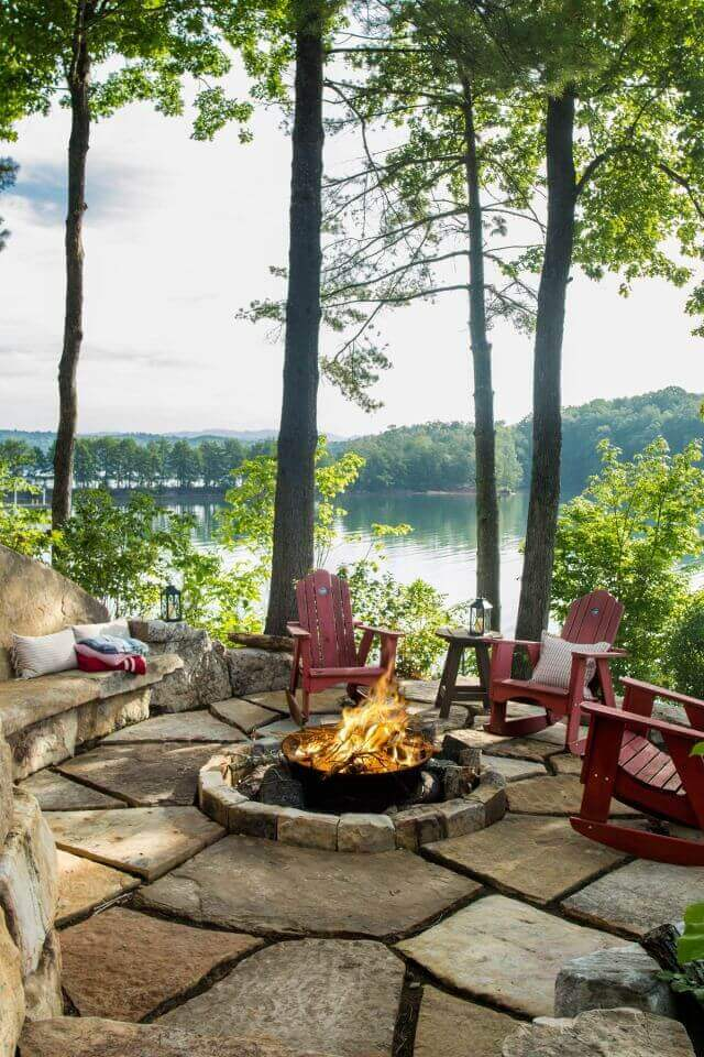 A Rustic Fire Overlooking the Lake   Awesome Firepit Area Ideas For Your Outdoor Activities