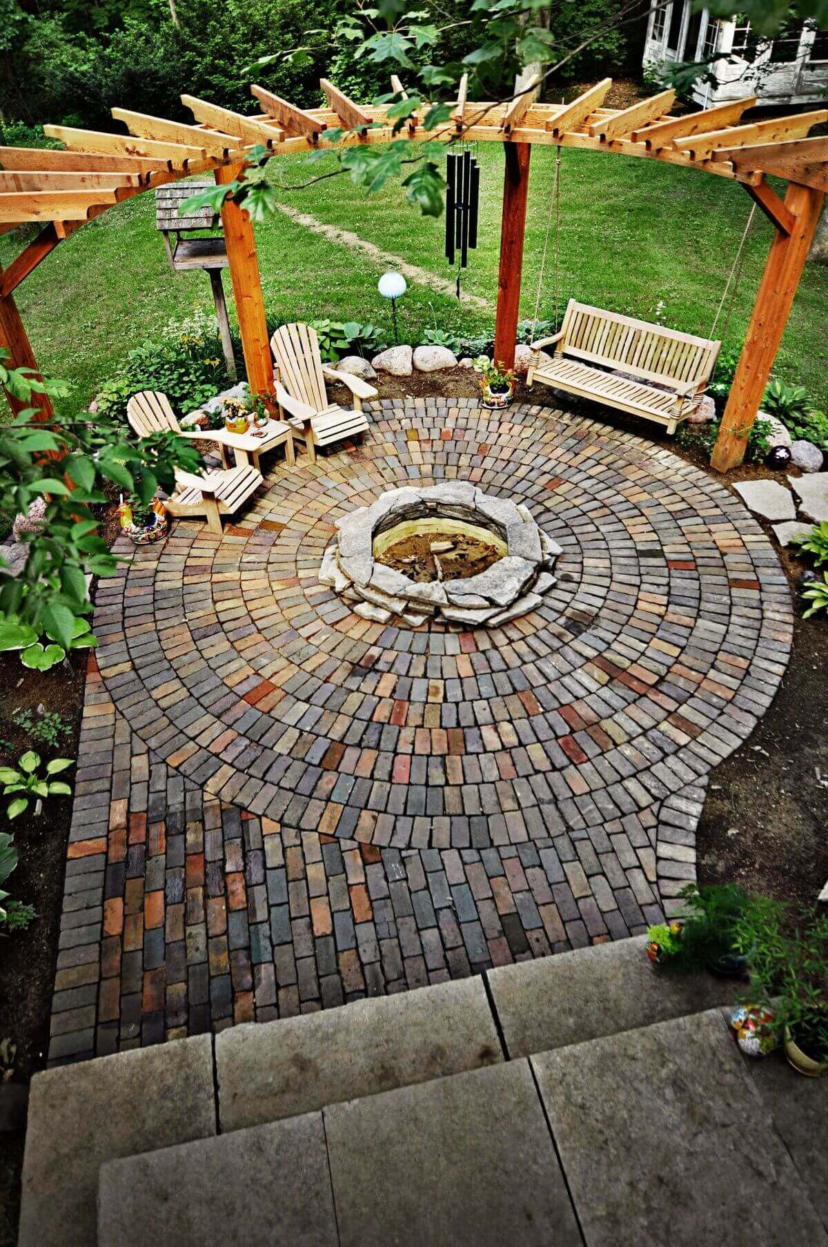 Swinging at the Edge of the Firepit   Awesome Firepit Area Ideas For Your Outdoor Activities