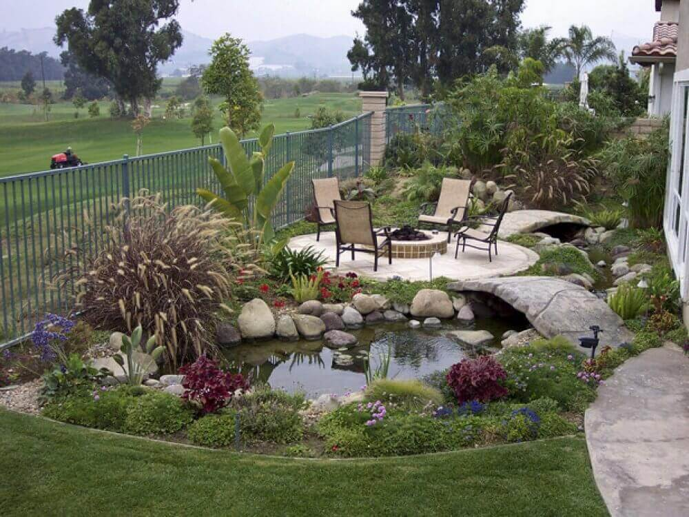 A Relaxing Spot Near a Garden Pond   Awesome Firepit Area Ideas For Your Outdoor Activities