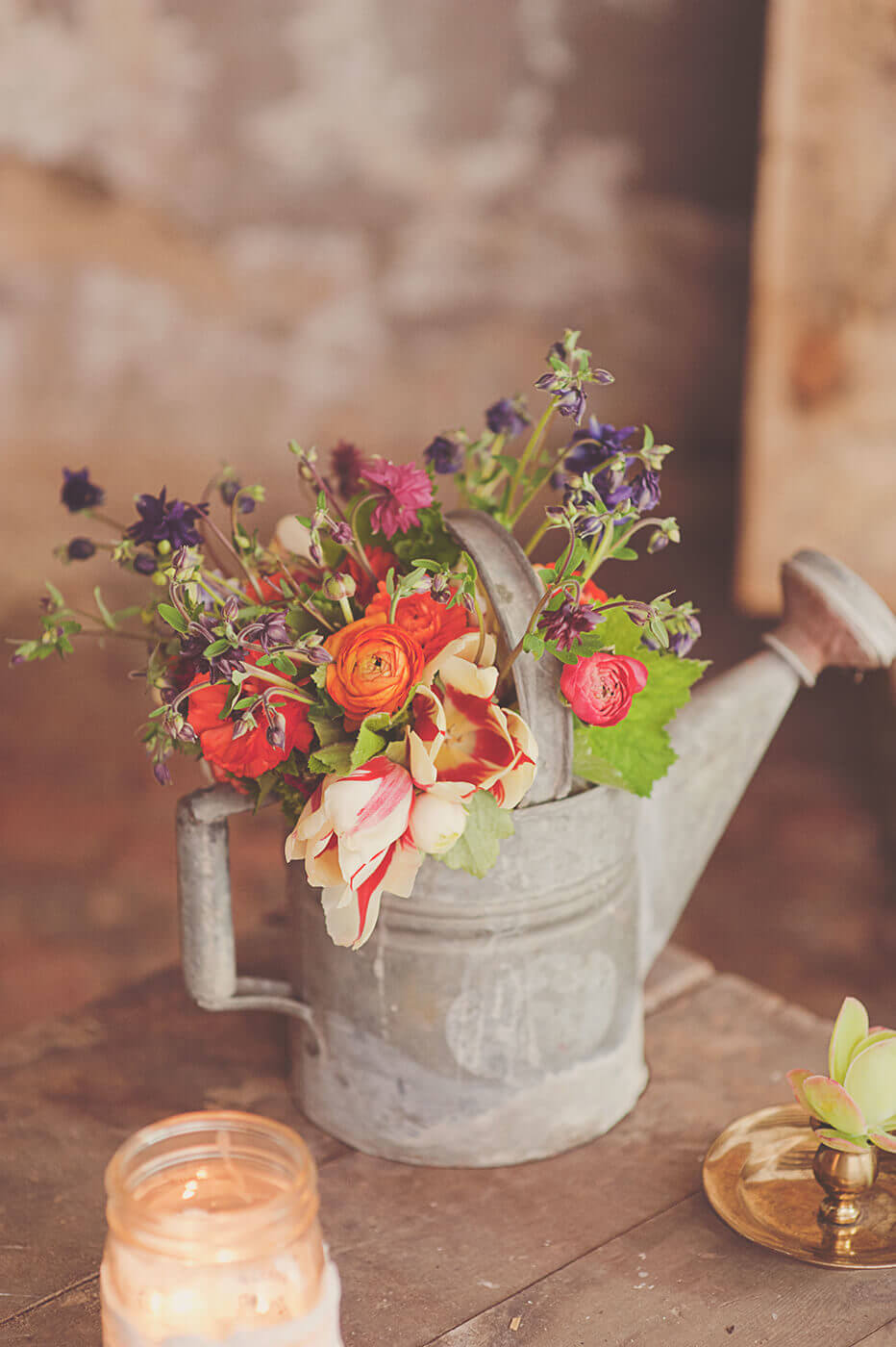 Vintage Garden Decor Ideas: Rustic Metal Watering Can Planter