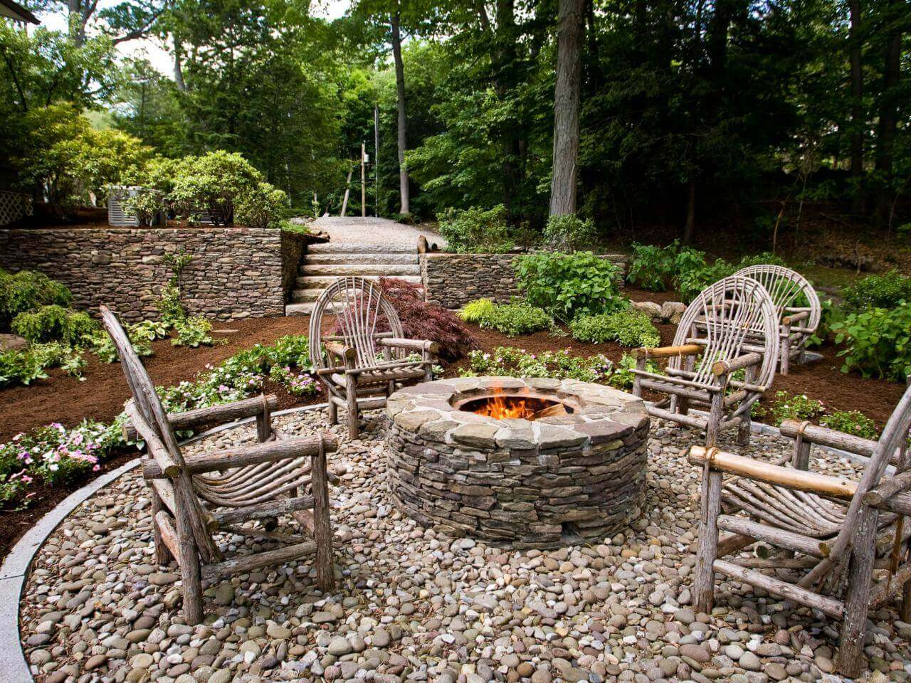 Wooden Seats Around a Stone Firepit   Awesome Firepit Area Ideas For Your Outdoor Activities