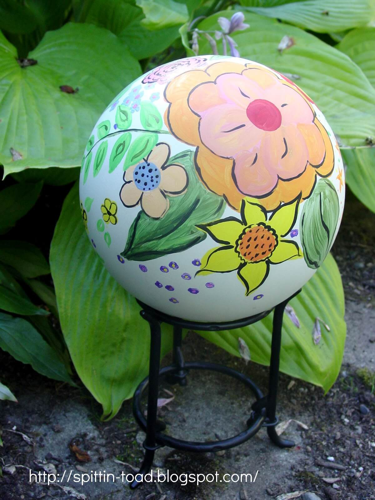 White Globe with Hand Painted Flowers | DIY Garden Ball Ideas