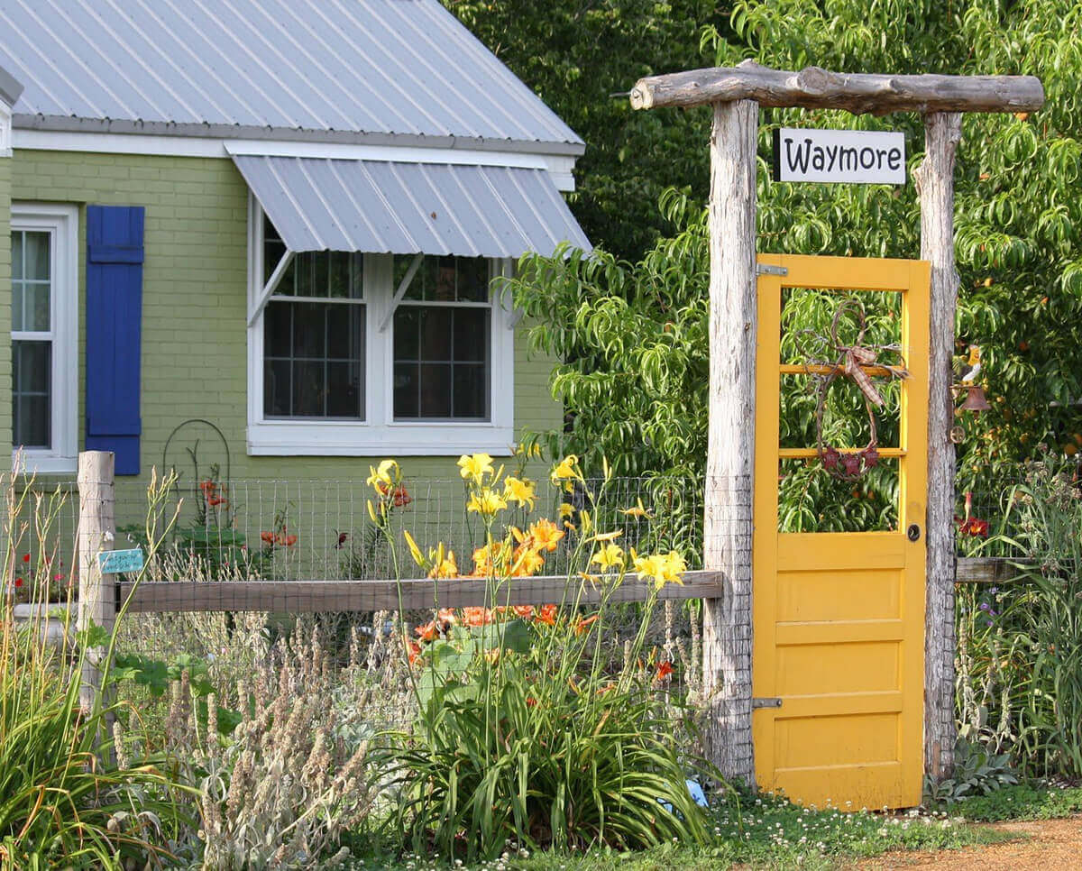 Cute Garden Gate with a Family Name | Creative Repurposed Old Door Ideas & Projects For Your Backyard