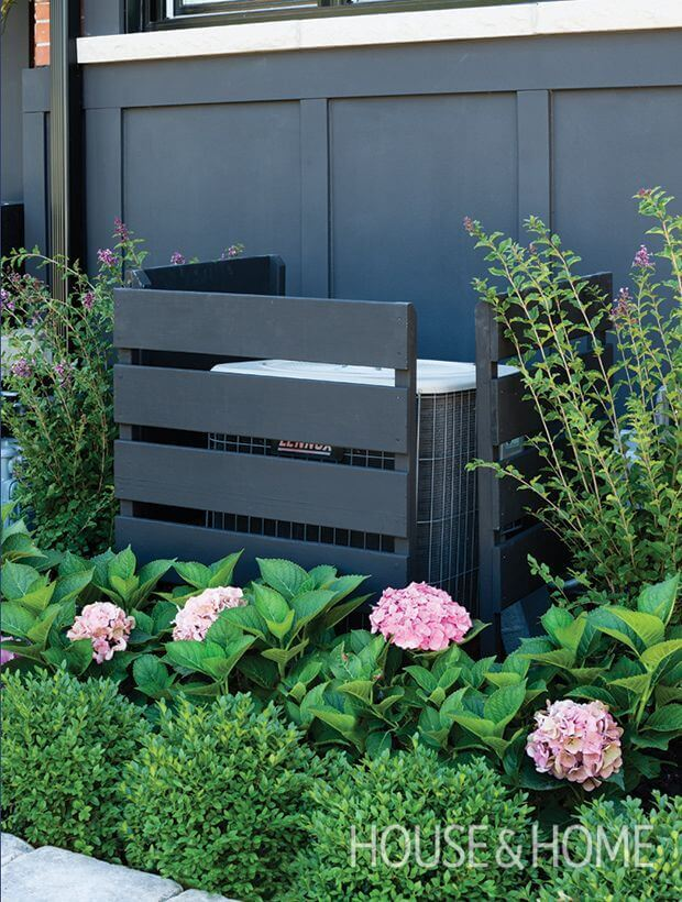 AC Unit Disappears Behind the Right Paint Color and Plants | Outdoor Eyesore Hiding Ideas