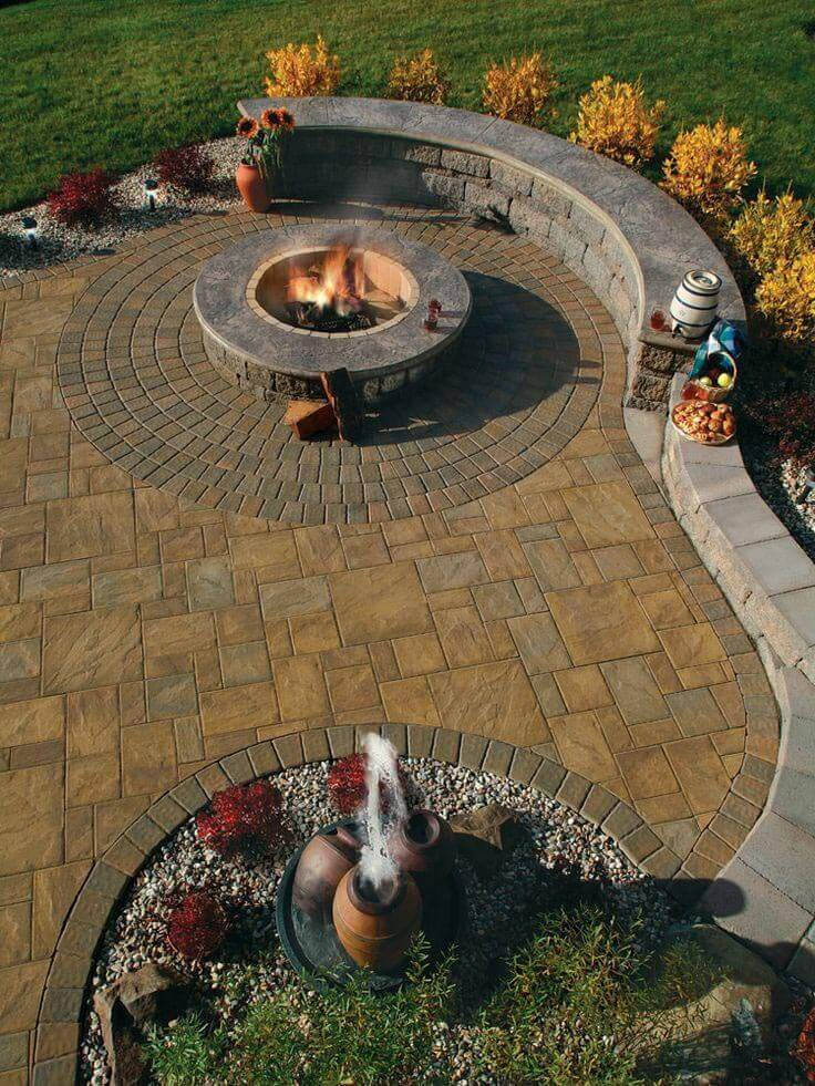 Firepit Alongside a Beautiful Garden Wall   Awesome Firepit Area Ideas For Your Outdoor Activities