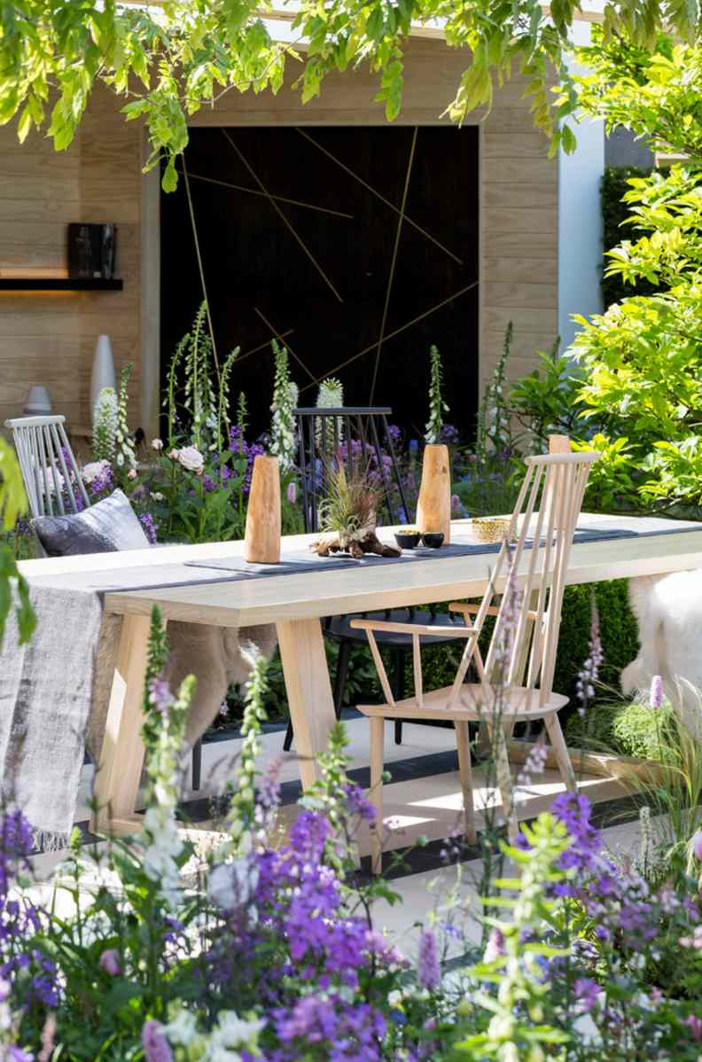 Elegant Dining Table Surrounded by Flowers