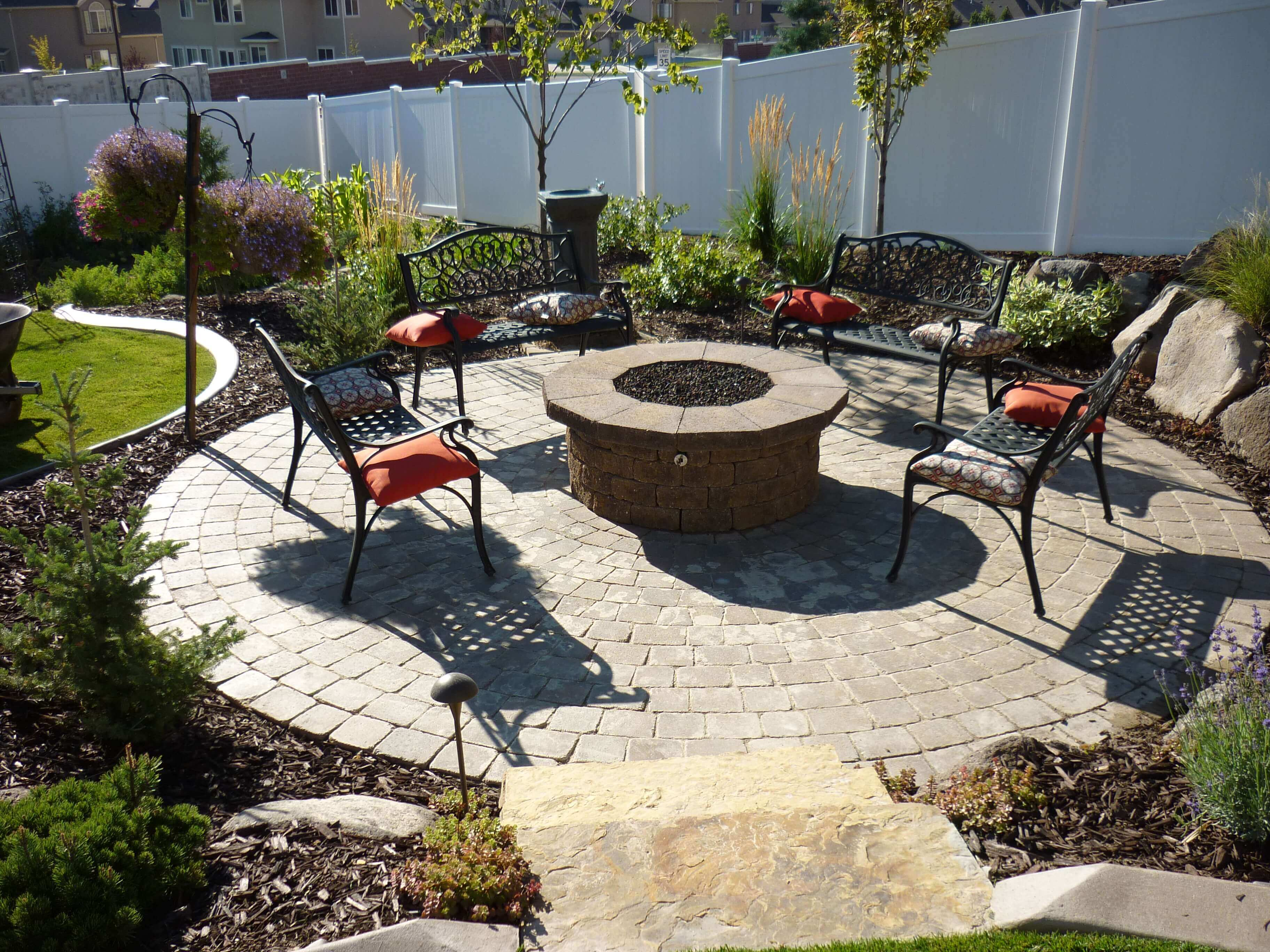 A Raised Pit in a Walled Garden   Awesome Firepit Area Ideas For Your Outdoor Activities