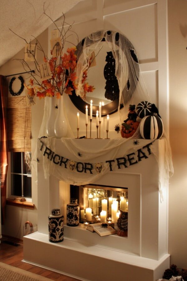 Seasonal Flowers, Gourds Complement Fireplace | DIY Indoor Halloween Decorating Ideas