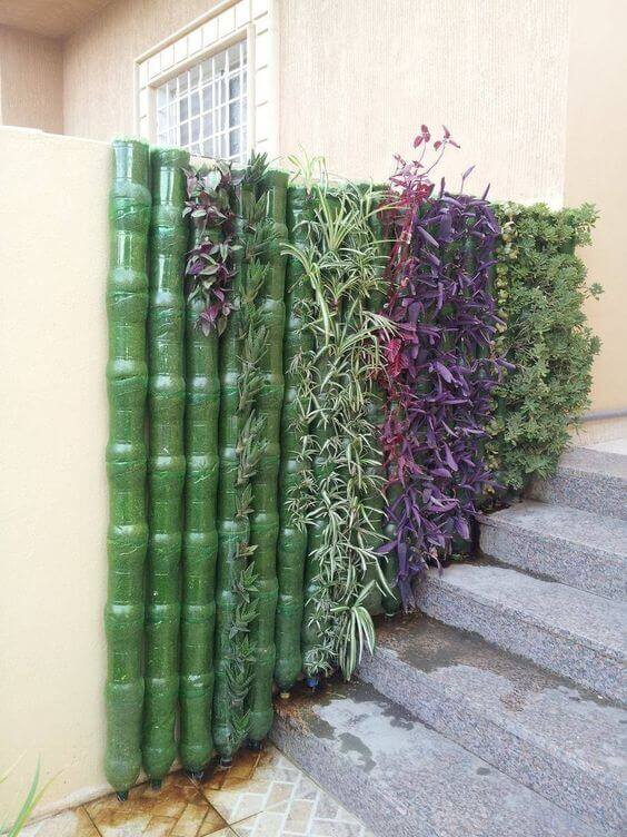 Green wall made from plastic bottles | Creative Plastic Bottle Vertical Garden Ideas - FarmFoodFamily.com