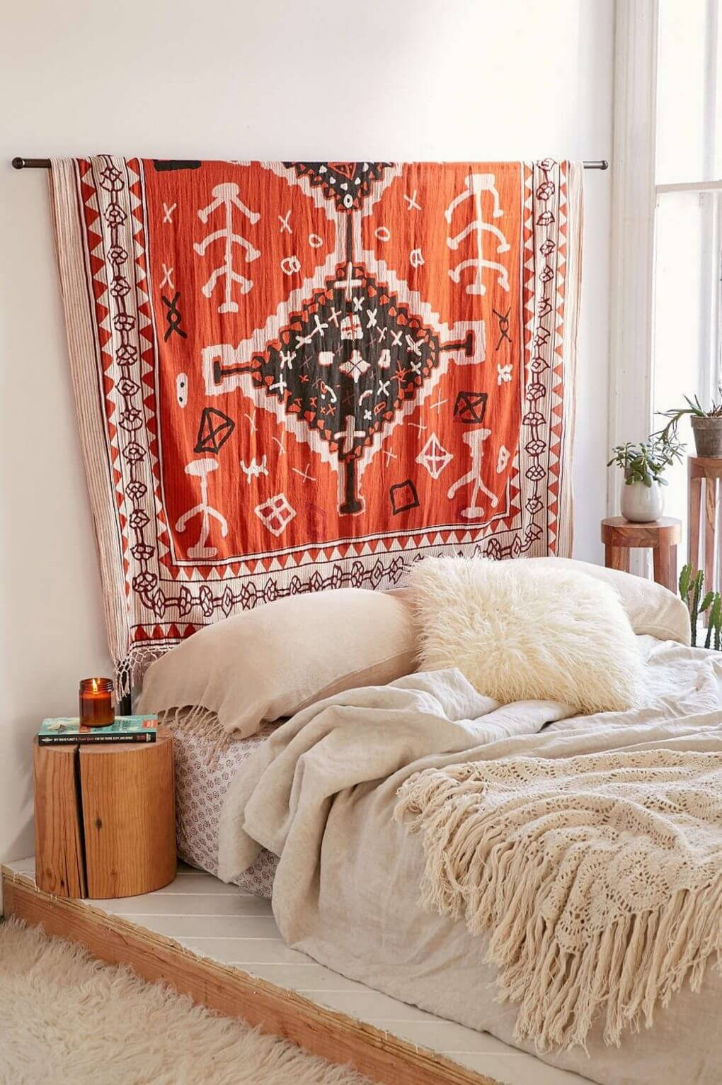 Minimal Bedroom With Leafy Decor and a Patterned Rug Above the Bed | Bohemian Chic Interior Design Ideas | FarmFoodFamily.com