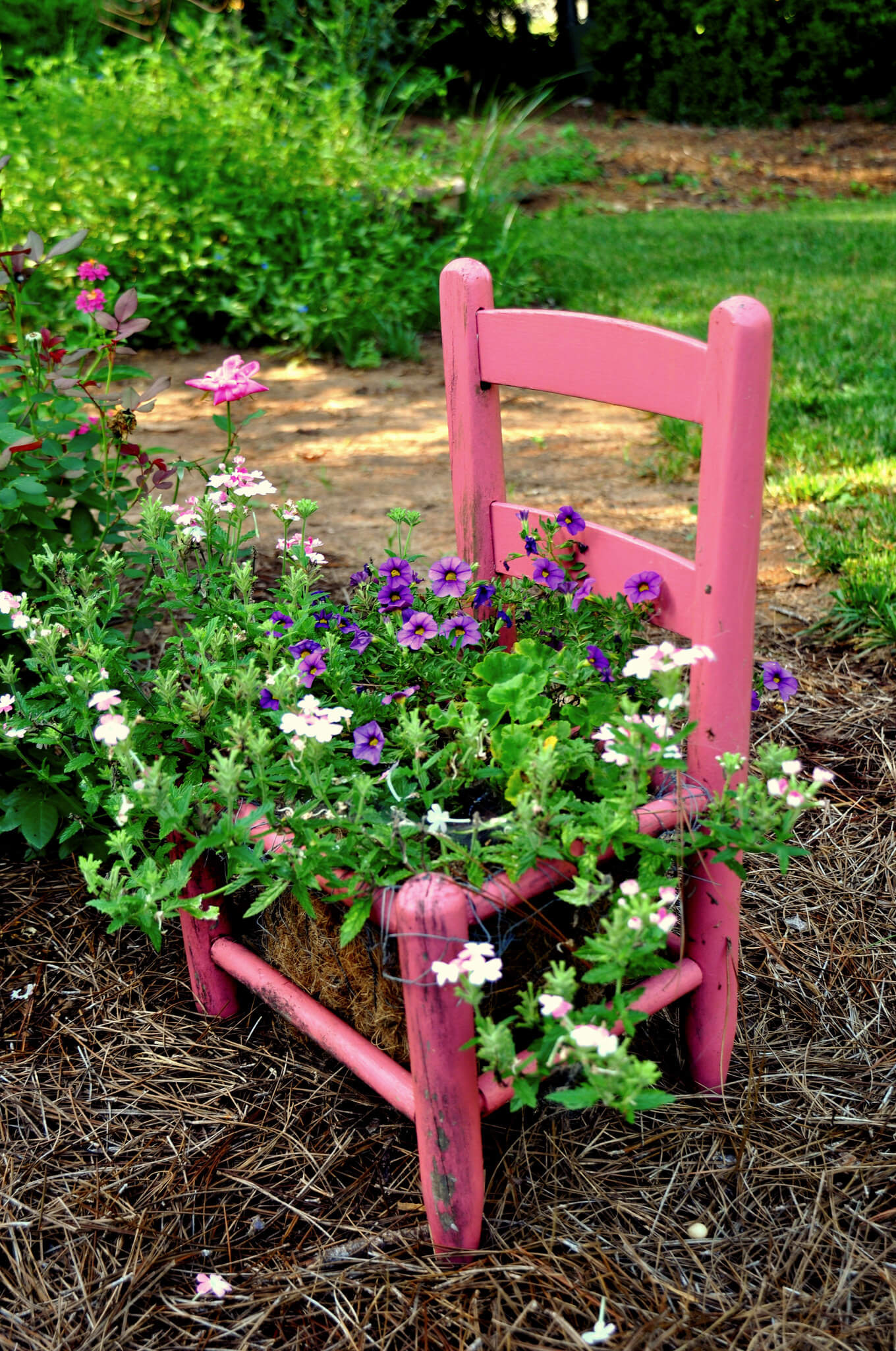 Pink chair planter   Creative Upcycled DIY Chair Planter Ideas For Your Garden