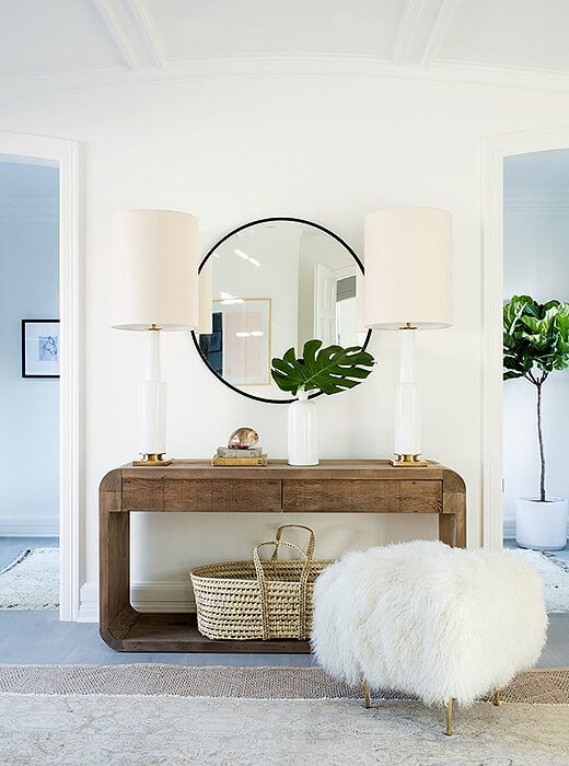A round mirror above a console table | Best Entryway Mirror Decor Ideas