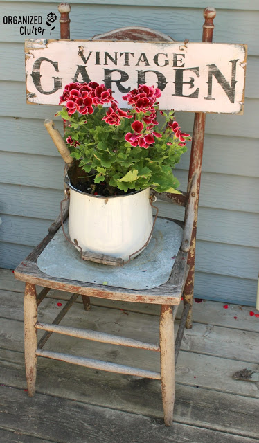 Vintage Sign on a Reclaimed Chair   Creative Upcycled DIY Chair Planter Ideas For Your Garden