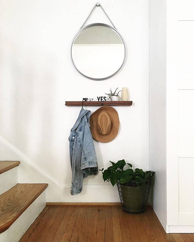 Wooden shelf with coat hooks and a mirror | Best Small Entryway Decor & Design Ideas | Small Mudroom Ideas | FarmFoodFamily.com