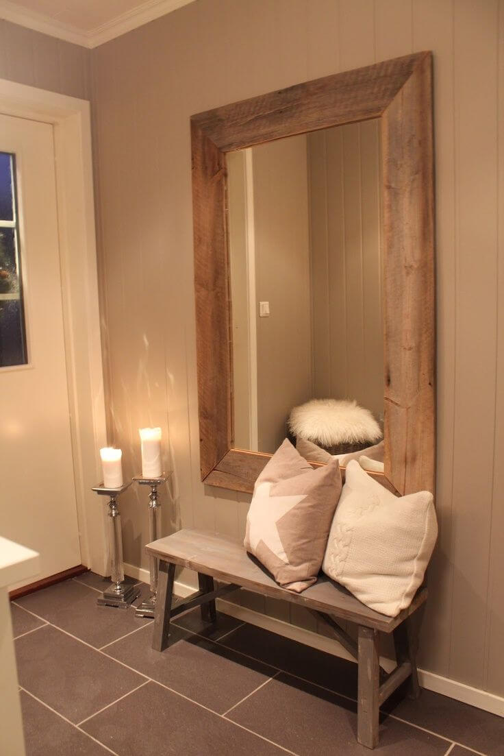 Large framed mirror above a wood bench | Best Entryway Mirror Decor Ideas