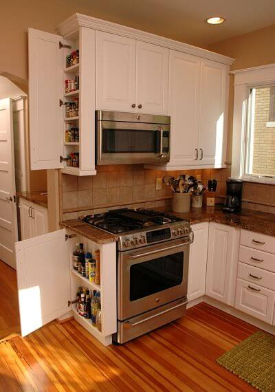Narrow cabinets installed on the side of a cupboard or base cabinet