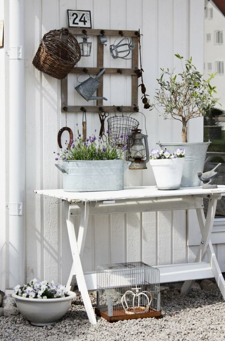 Old window is mounted on the wall of garden shed | Creative DIY Outdoor Window Decor Ideas