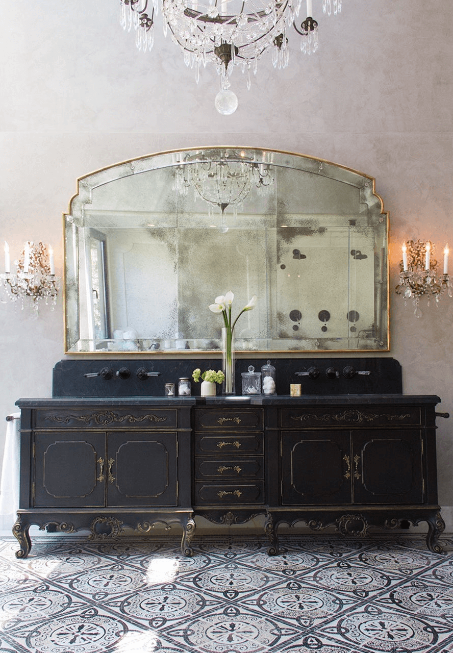 Black vanity with a cement tile