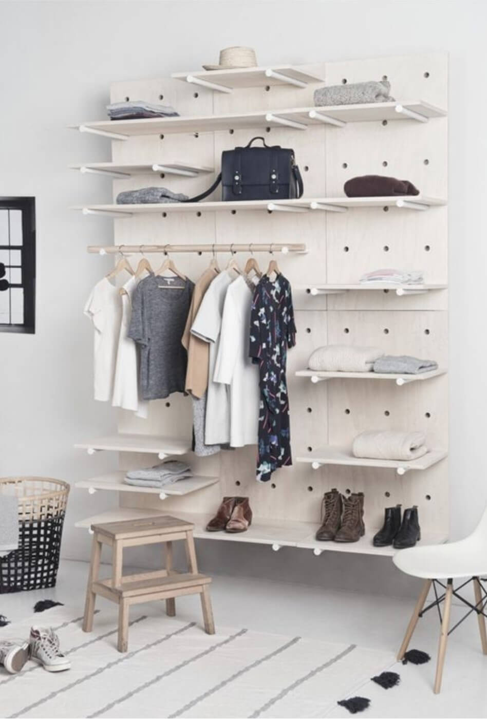 Wardrobe in white tone made with wood, fixed to the wall