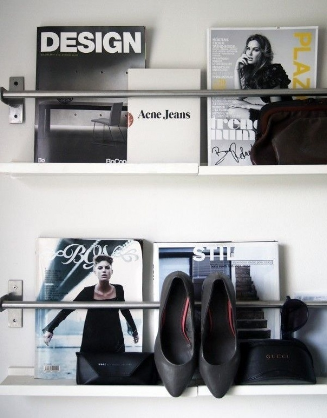 tubes attached to the wall placed to organize magazines and accessories