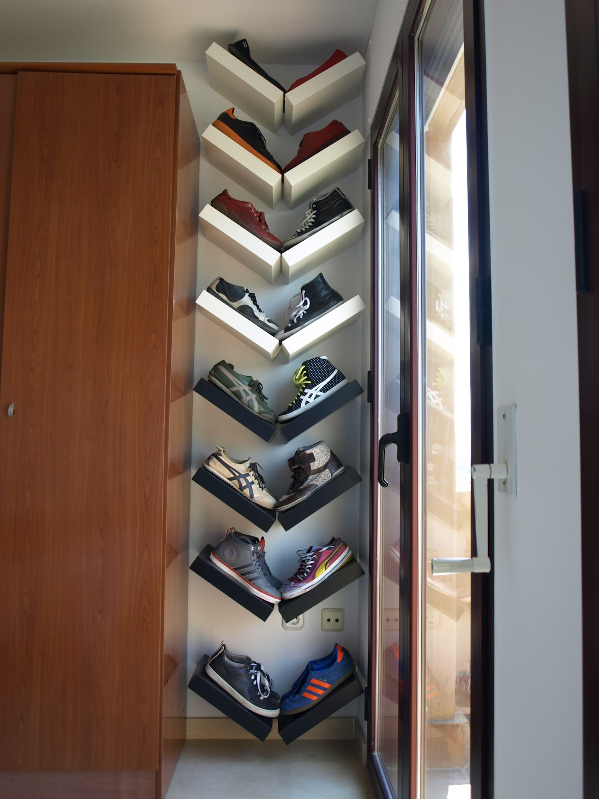 Wooden frames placed in a V shape to organize shoes
