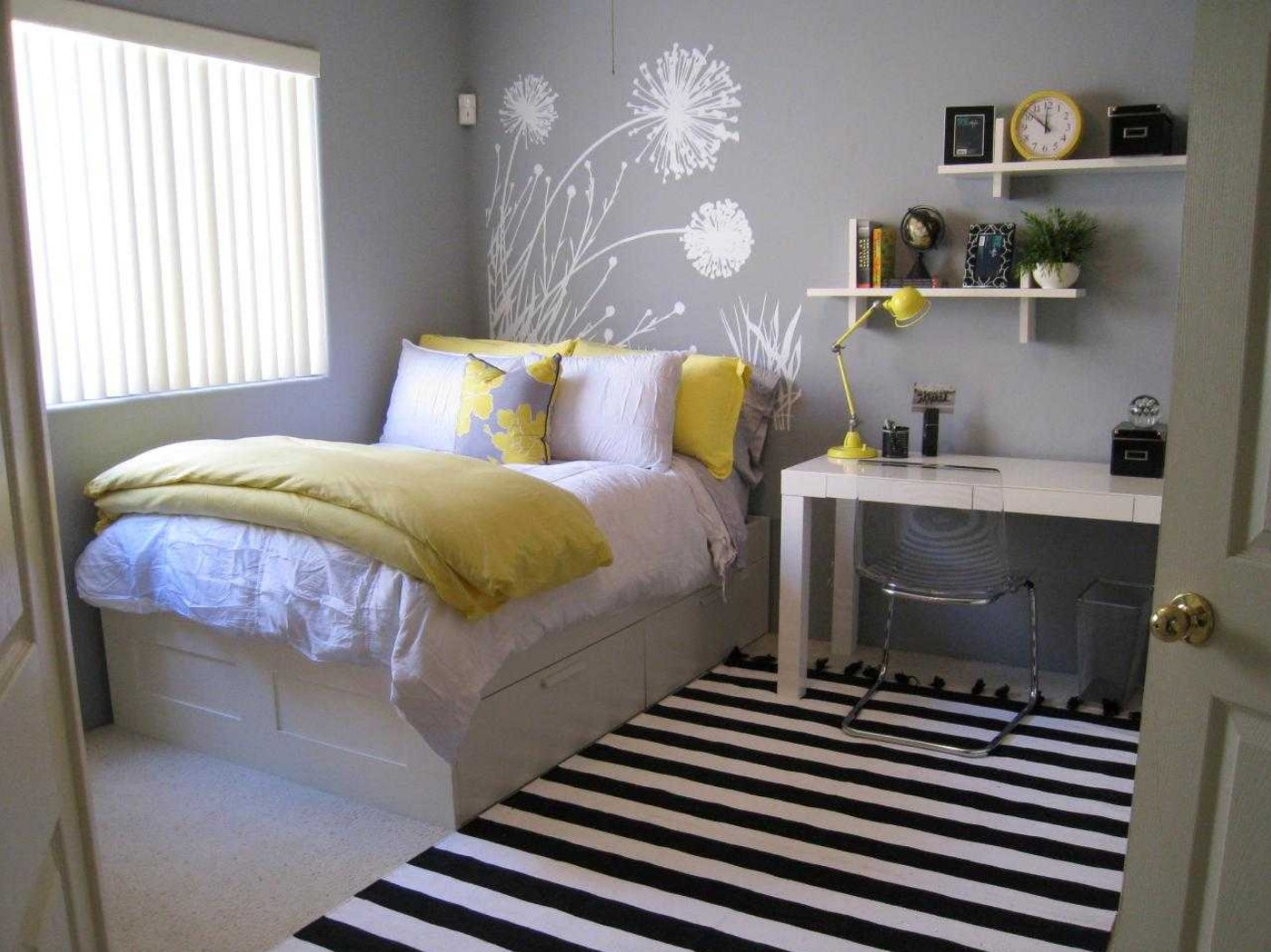 Gray room with yellow and a dandelion drawn on the wall