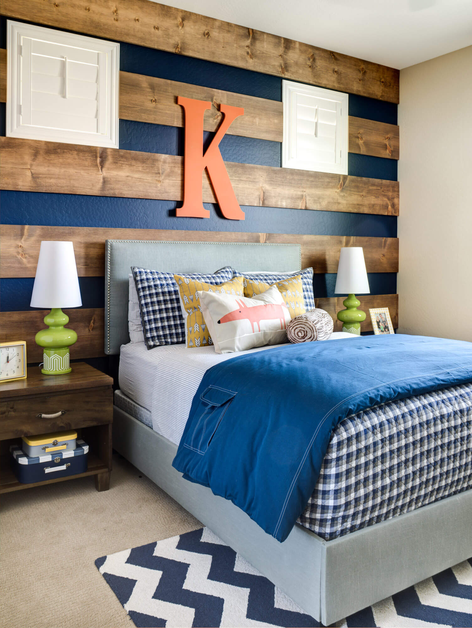 Large stained boards over a navy blue wall