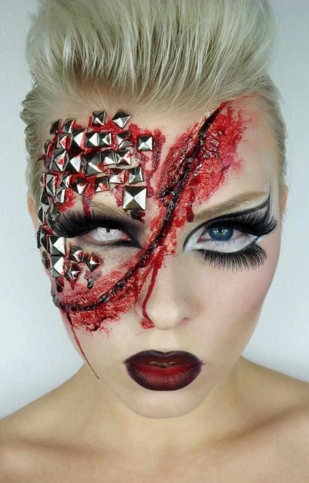 Girl with makeup for halloween with a wound in the middle of the face and estoperoles