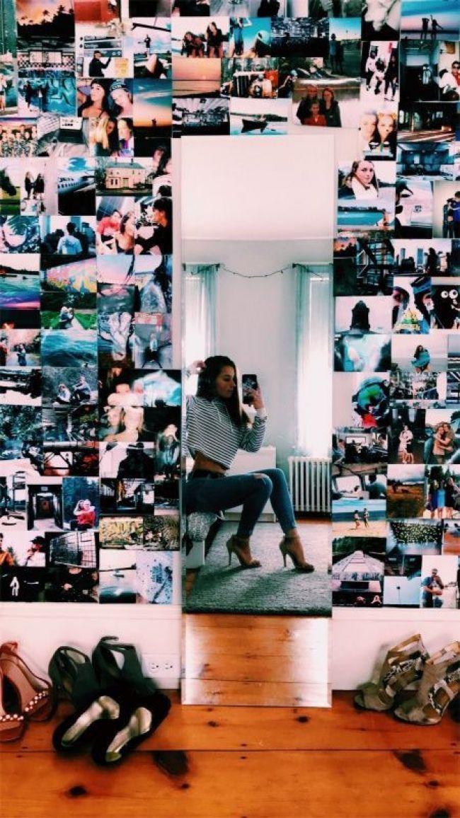 Woman with photo wall and mirror in her room