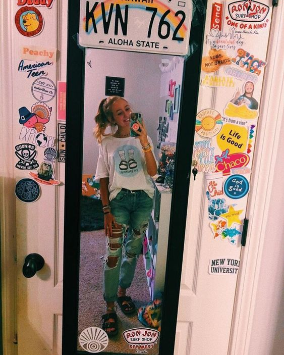 Woman in front of mirror with prints on the door