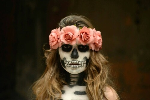 Girl with makeup for catrina halloween with flowers