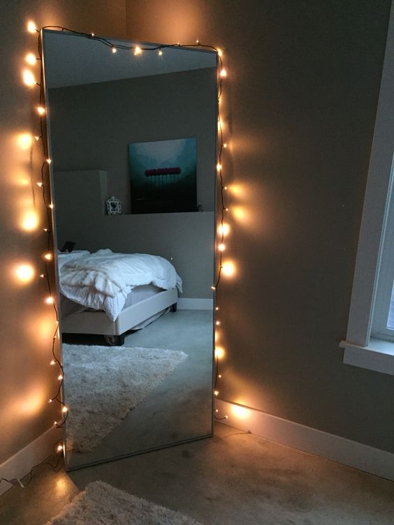 Standing mirror with lights in a corner