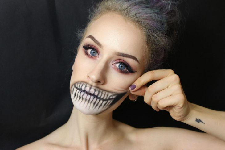 Girl with makeup for halloween With the mouth in the shape of a skull