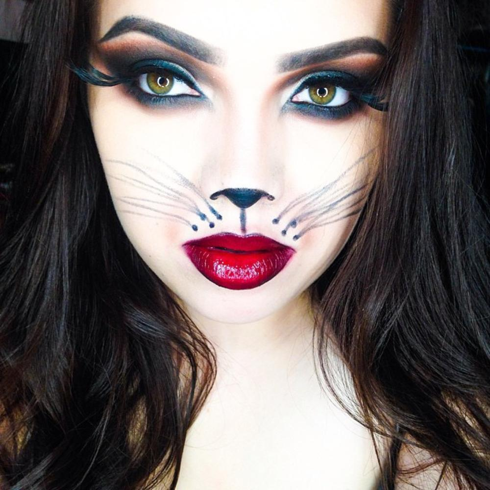 Girl with makeup for cat halloween