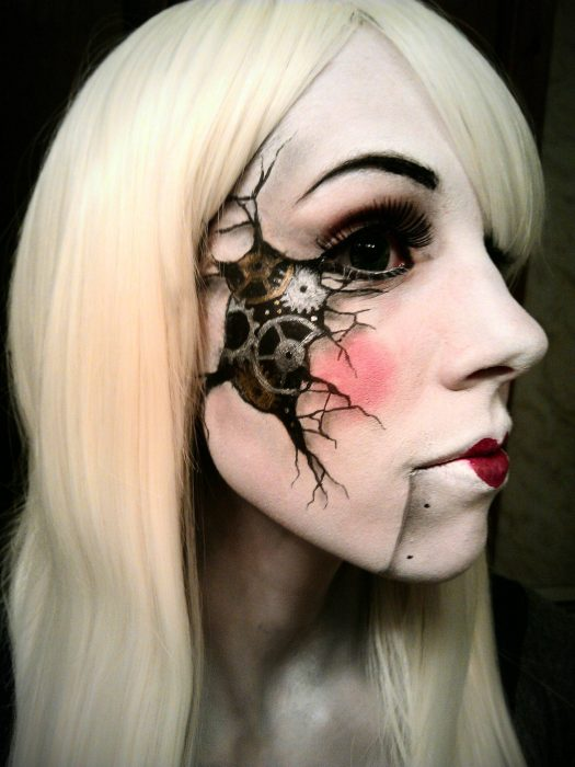 Girl with makeup for halloween with a mesh in the cheek