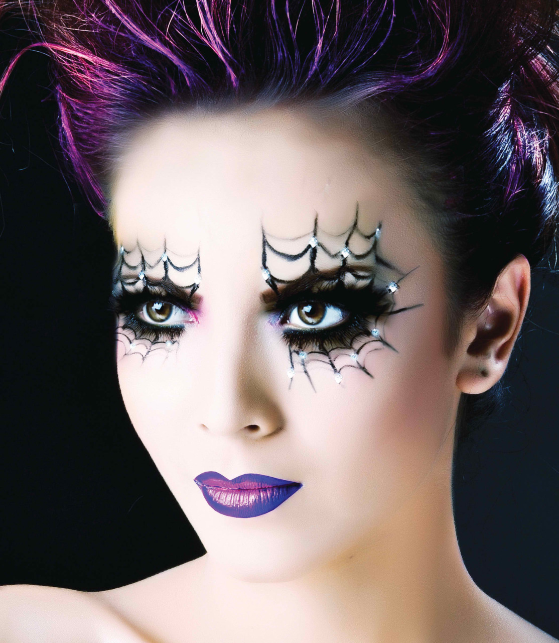 Girl with halloween makeup with cobwebs on her eyes