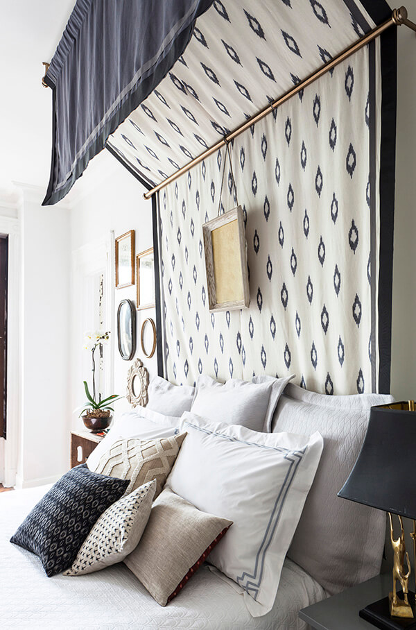 Use a thick patterned fabric to make a canopy so you can also use it as a headboard