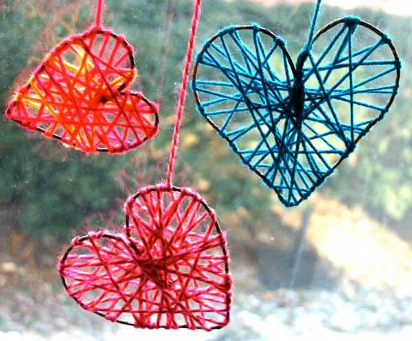 Hanging yarn hearts | Heart-Shaped Crafts For Valentine's Day