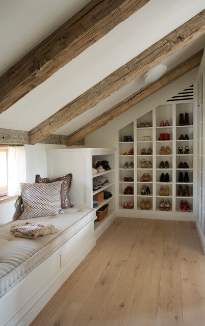 A cubical storage spaces for shoes along with the slanted wall