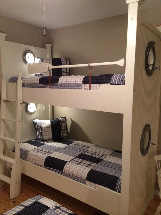 Lightly lit white bunk beds