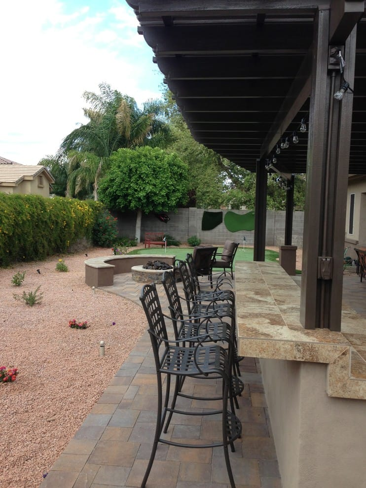 a mid-sized drought-tolerant backyard concrete paver landscaping in Phoenix.